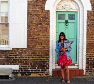 Woman in front of a Deal door